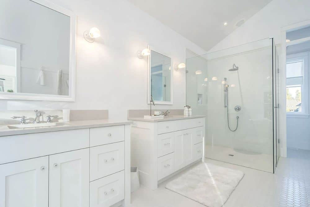 Double vanities and a walk-in shower complete the primary bedroom.
