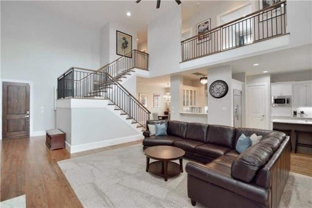 The family room opens into the kitchen and can be viewed from the second-floor balcony.