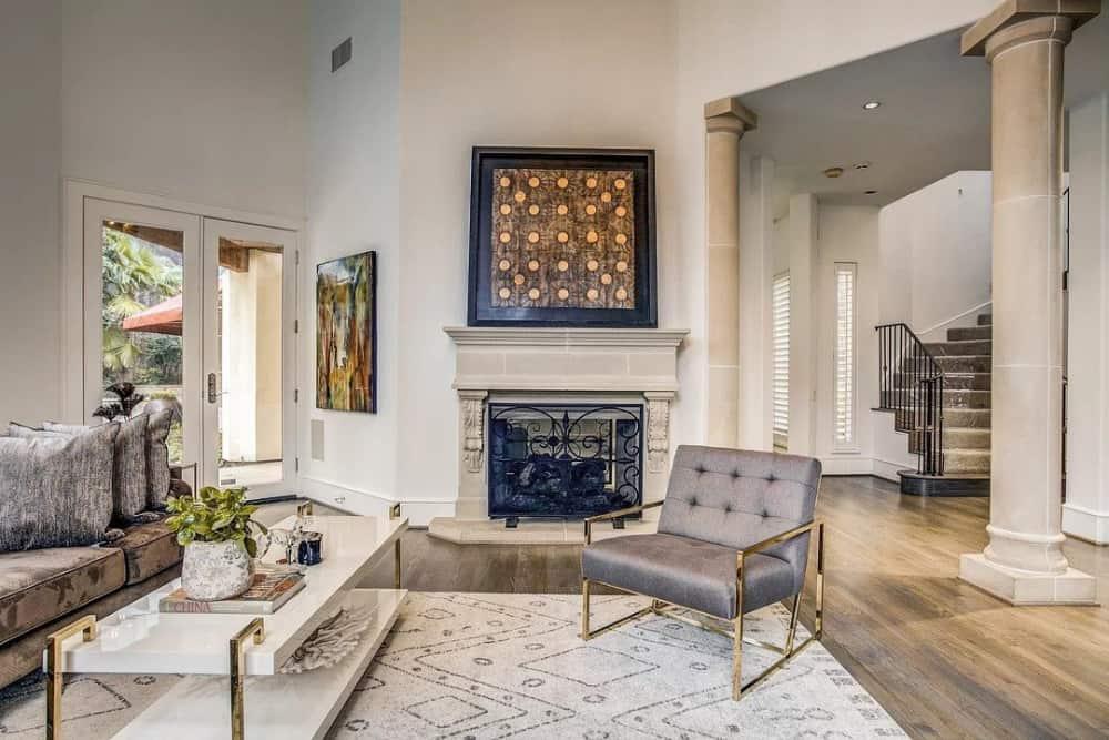 A large framed artwork adorns the fireplace.