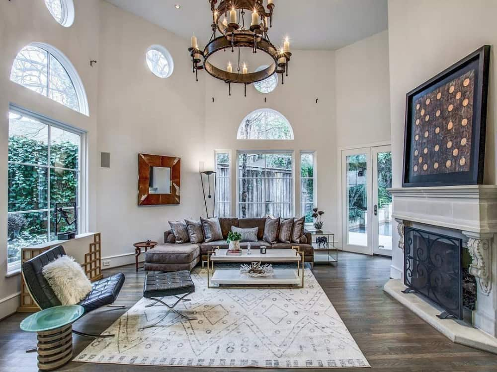 Surrounding windows and a french door flood the family room with natural light.
