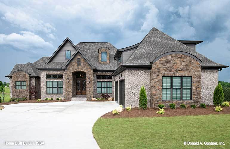 Two-Story 5-Bedroom The Hollowcrest European Inspired Home for a Sloping Lot with Courtyard Entry Garage and Bonus Room