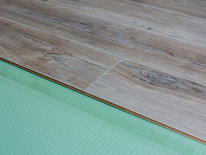 This is a close look at a flooring under construction with additional layer for soundproofing.