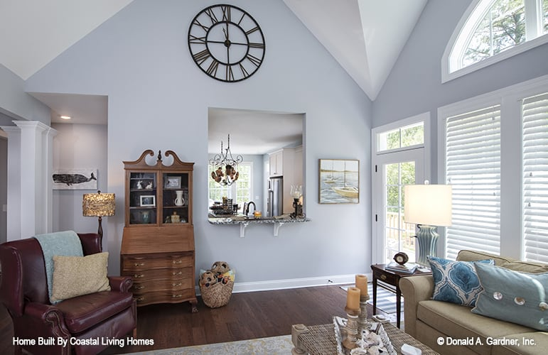 A window with a counter overlooks the kitchen.