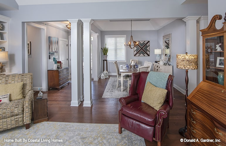 An open layout showing the great room, foyer, and formal dining room defined by interior columns.