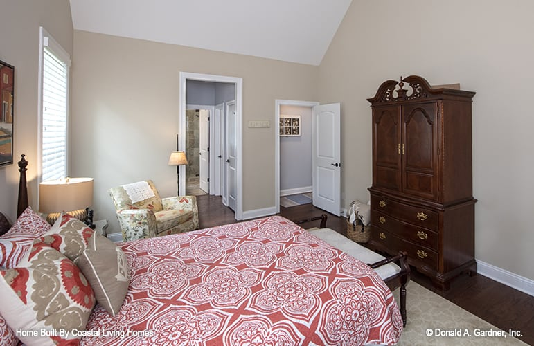 The primary bedroom includes a wooden wardrobe and a private bath.