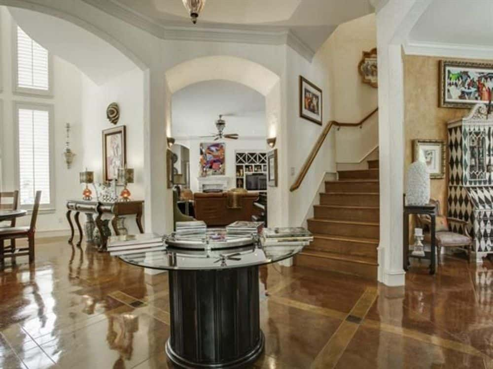 A round center table sets a nice focal point to the foyer.