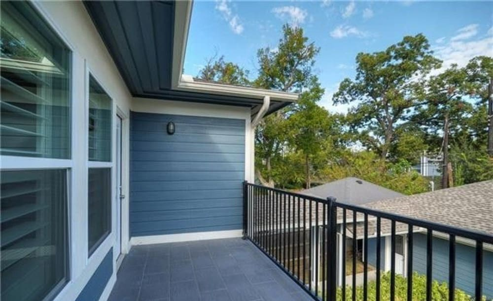 The primary bedroom includes a private balcony overlooking the garage.