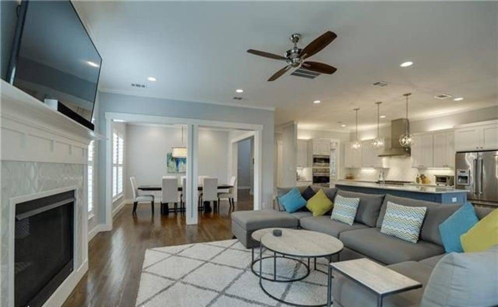 The family room opens into the formal dining room and gourmet kitchen.