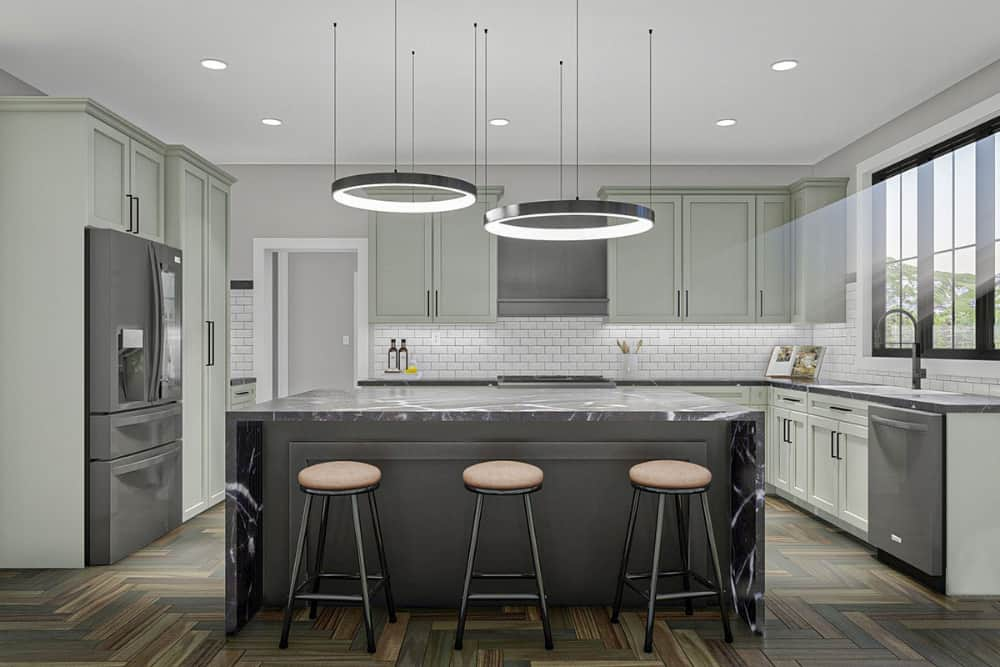 The kitchen is equipped with white cabinetry, slate appliances, and a breakfast island topped with oversized round pendants.The kitchen is equipped with white cabinetry, slate appliances, and a breakfast island topped with oversized round pendants.