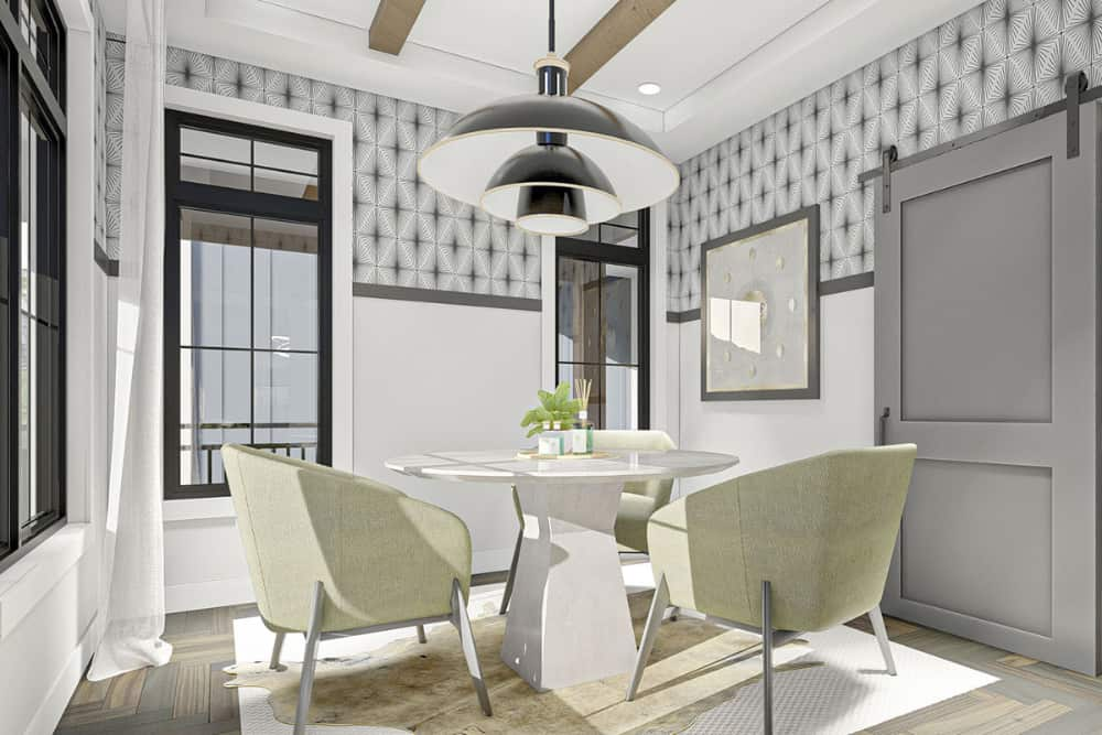 Breakfast nook with dome pendants and a round dining set sitting on layered rugs.