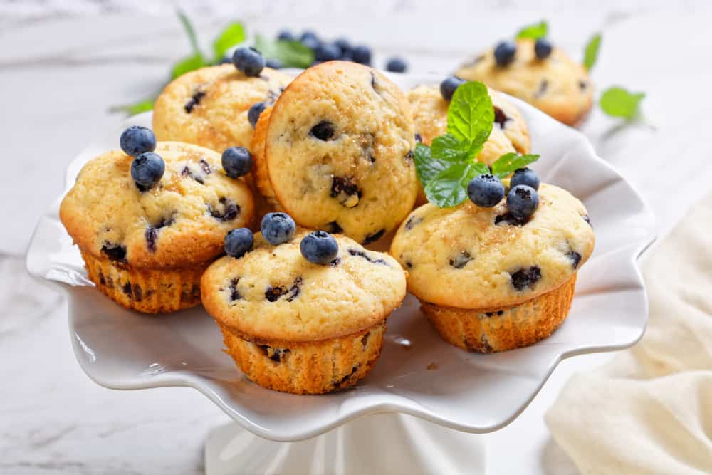This is a batch of blueberry buttermilk breakfast cupcakes on a platter.