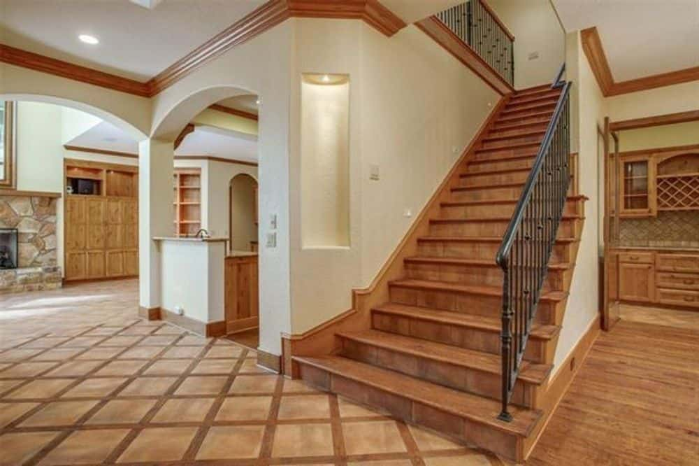 The foyer flows into the kitchen and family room.