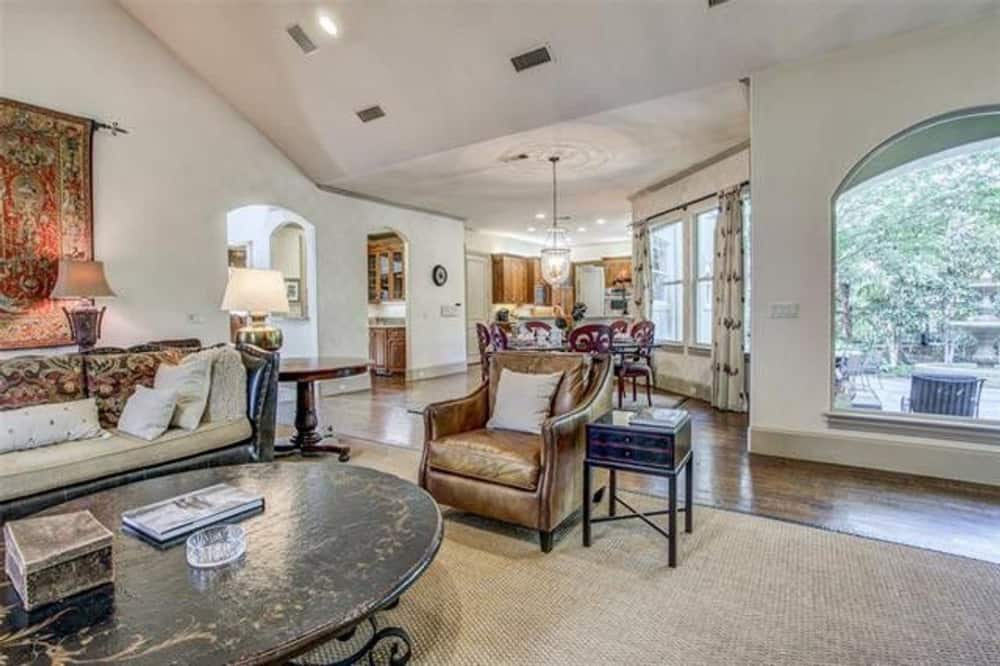 Family room with leather seats and an antique coffee table sitting on a jute area rug.