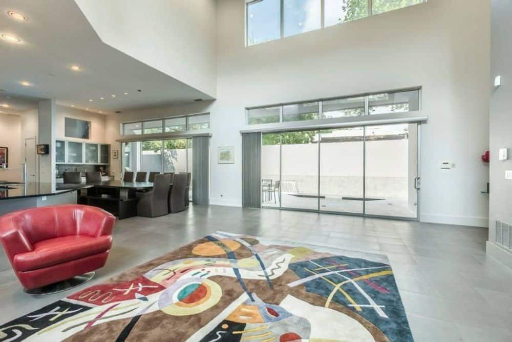 Oversized sliding glass doors extend the living space onto the veranda.