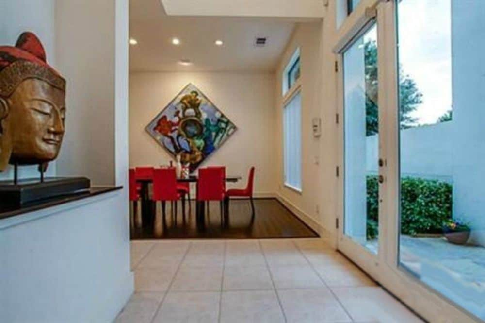 Foyer with a glazed entry door and a wall niche filled with contemporary decors.