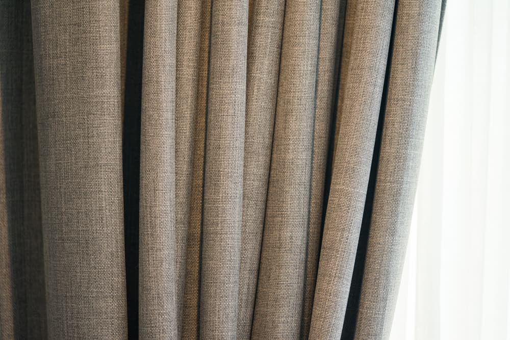 This is a close look at a thick gray soundproof curtain.