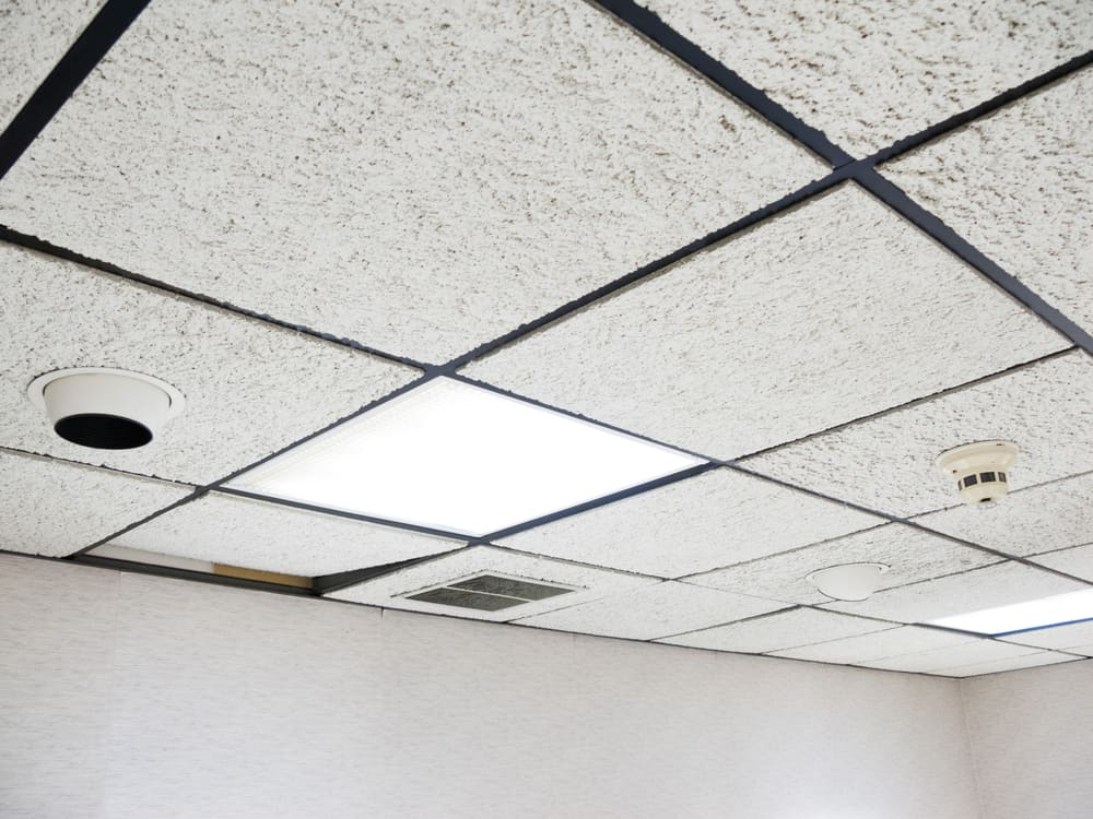 This is a close look at the ceiling that has textured soundproof panels.