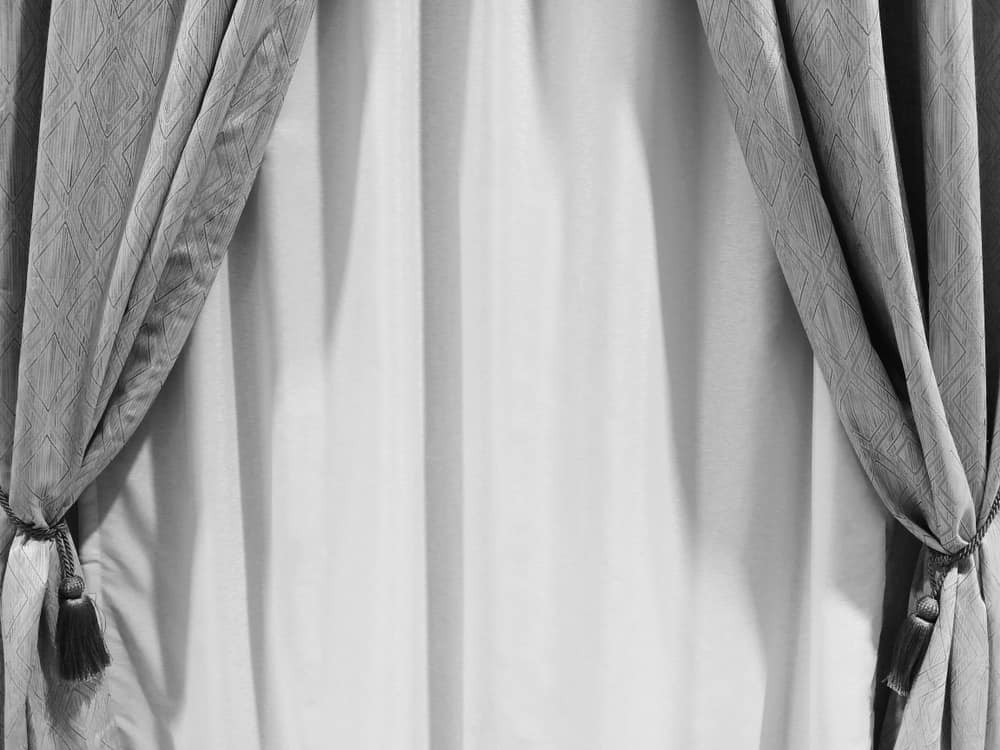 This is a close look at a set of gray soundproof curtains.