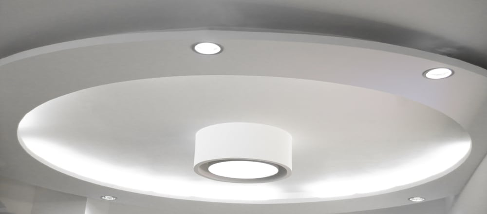 This is a close look at a white drop ceiling with recessed lights.
