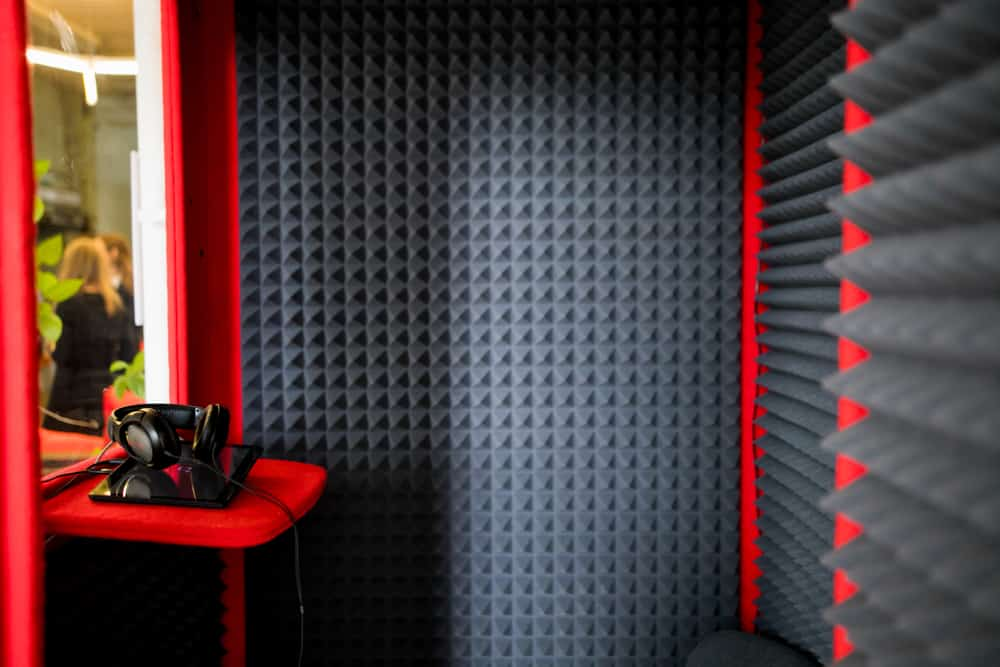 This is an interior look at a sound recording booth with soundproof walls.