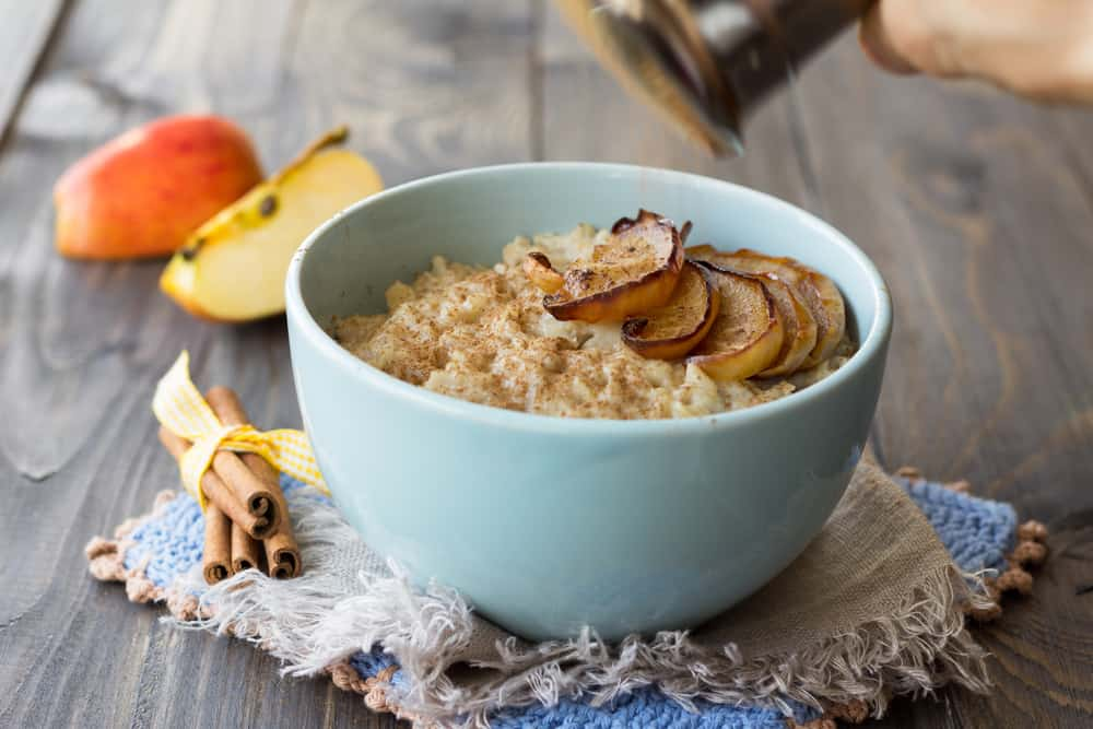 This is a bowl of hot oatmeal breakfast with apple cinnamon.