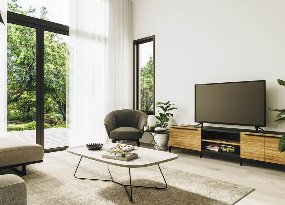 A round back armchair complements the flat-screen TV.