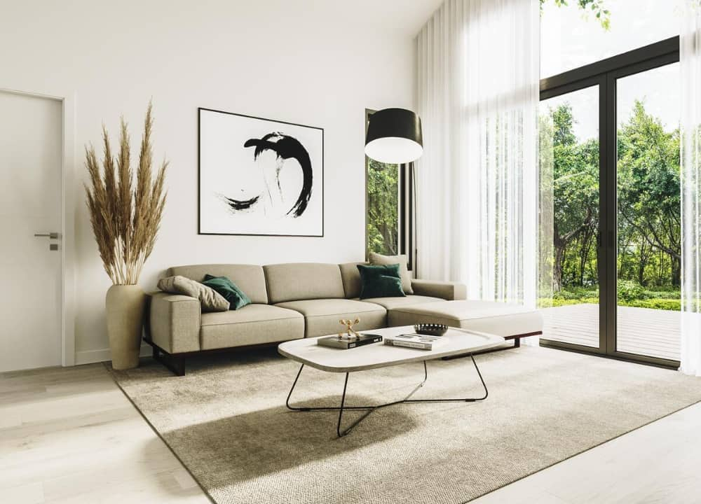 The living room is decorated with a large decorative vase and a lovely artwork fixed above the beige sofa.