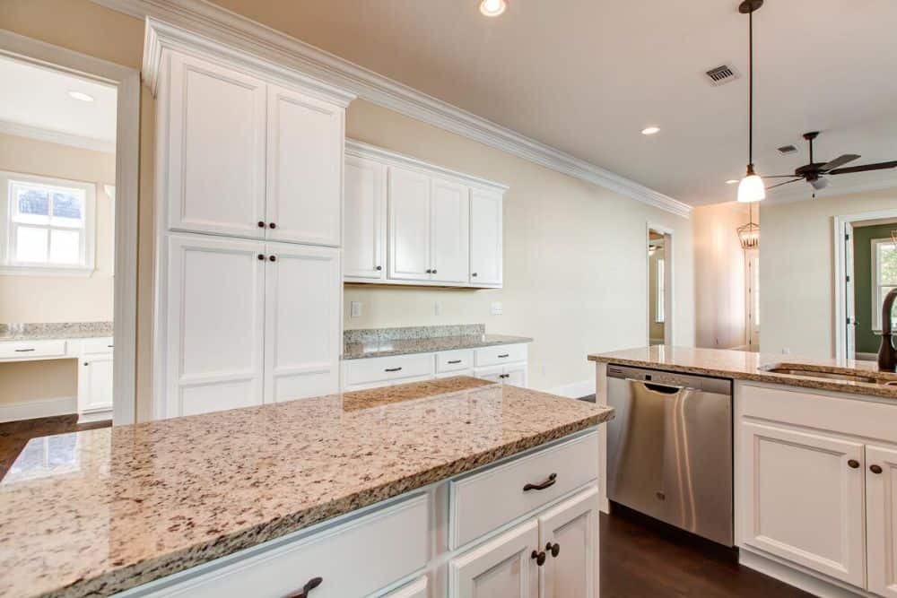 The kitchen includes a center island perfect for casual dining.