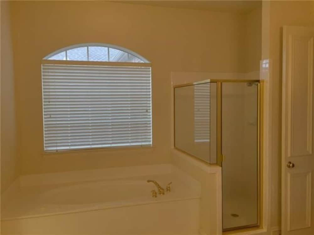 A drop-in bathtub and walk-in shower complete the primary bathroom.