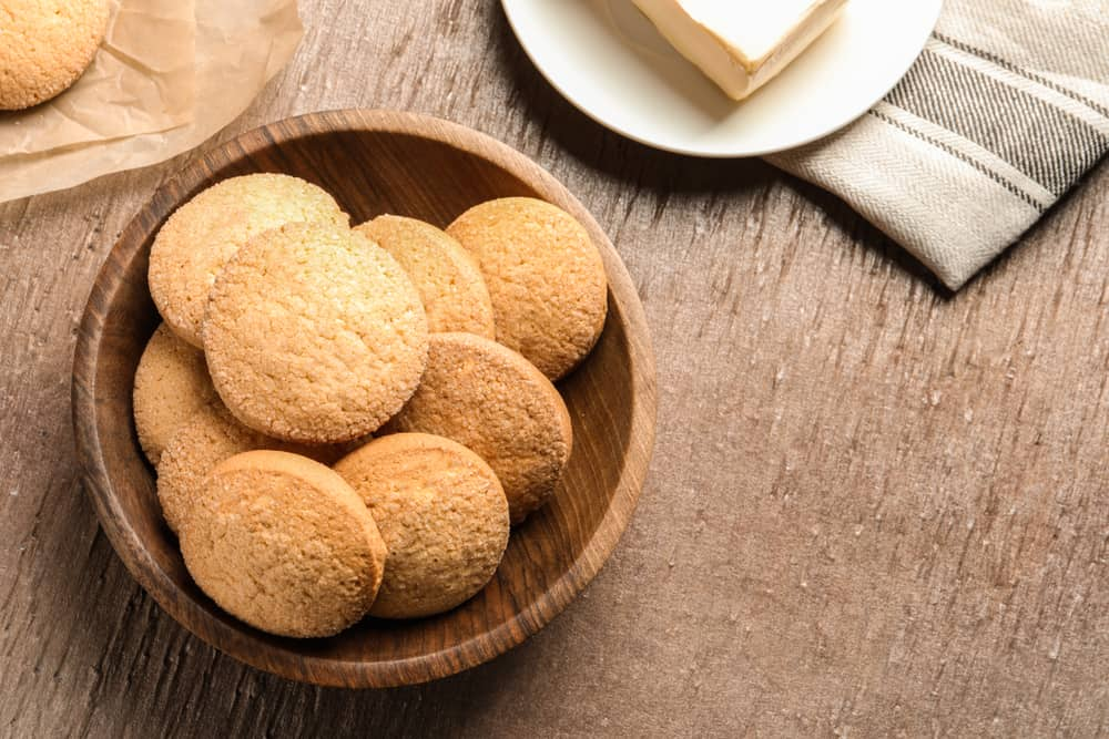 This is a wooden bowl filled with apple butter cookies.
