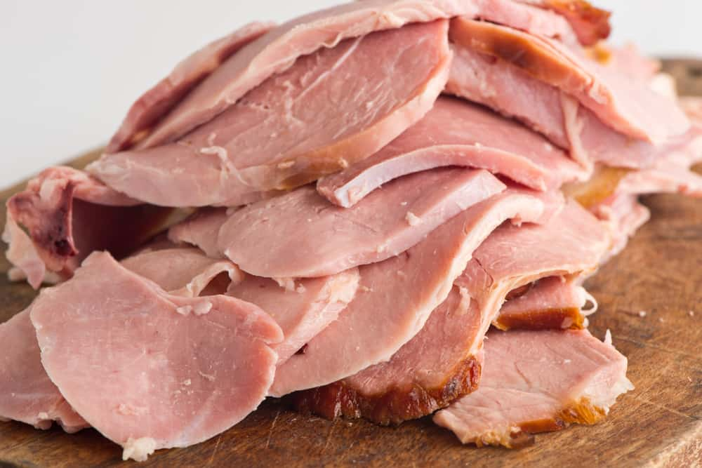 This is a close look at a  bunch of sliced country ham.