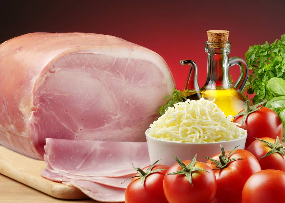 This is a large slab of York Ham with cheese, tomatoes and olive oil on the side.