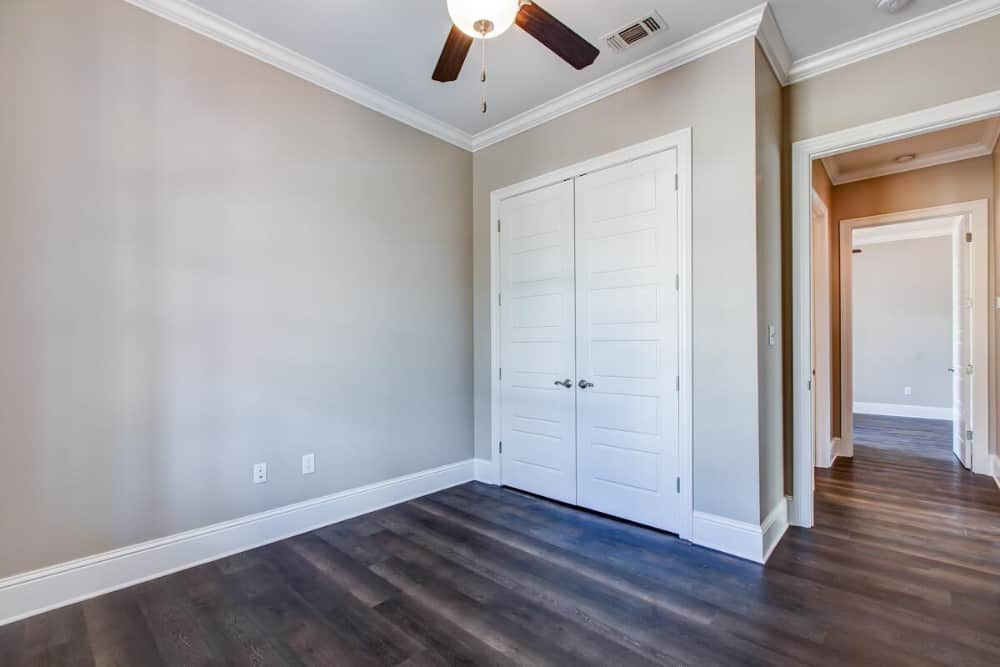 A walk-in pantry concealed behind the double doors completes the kitchen.