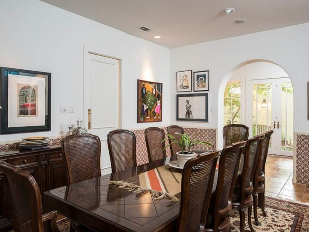 An archway off the dining area leads to the gourmet kitchen.