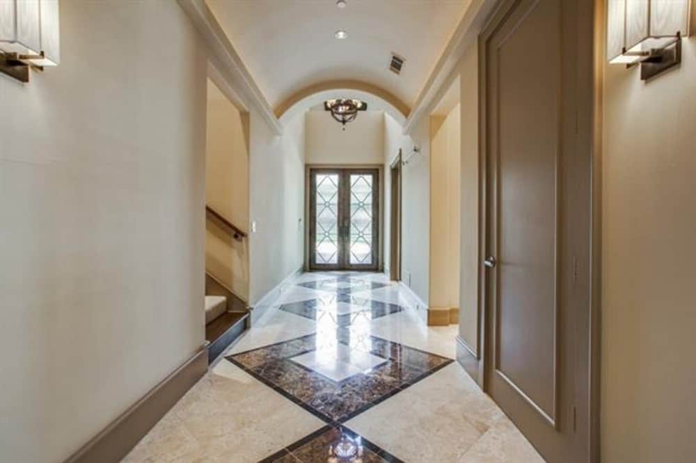 Foyer with a french entry door, marble tile floor, and a barrel-vaulted ceiling.