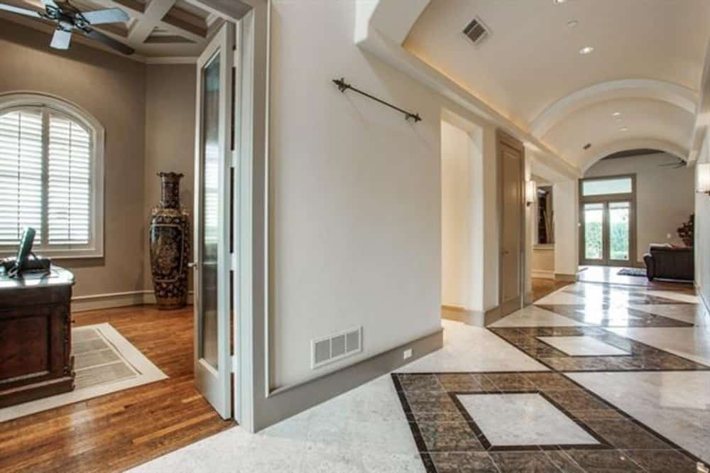 Off the foyer is the study crowned with a coffered ceiling.