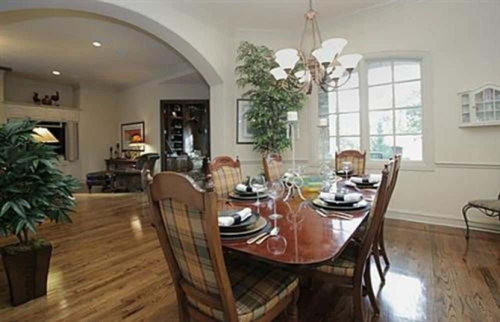 An arched window floods the dining area with natural light.