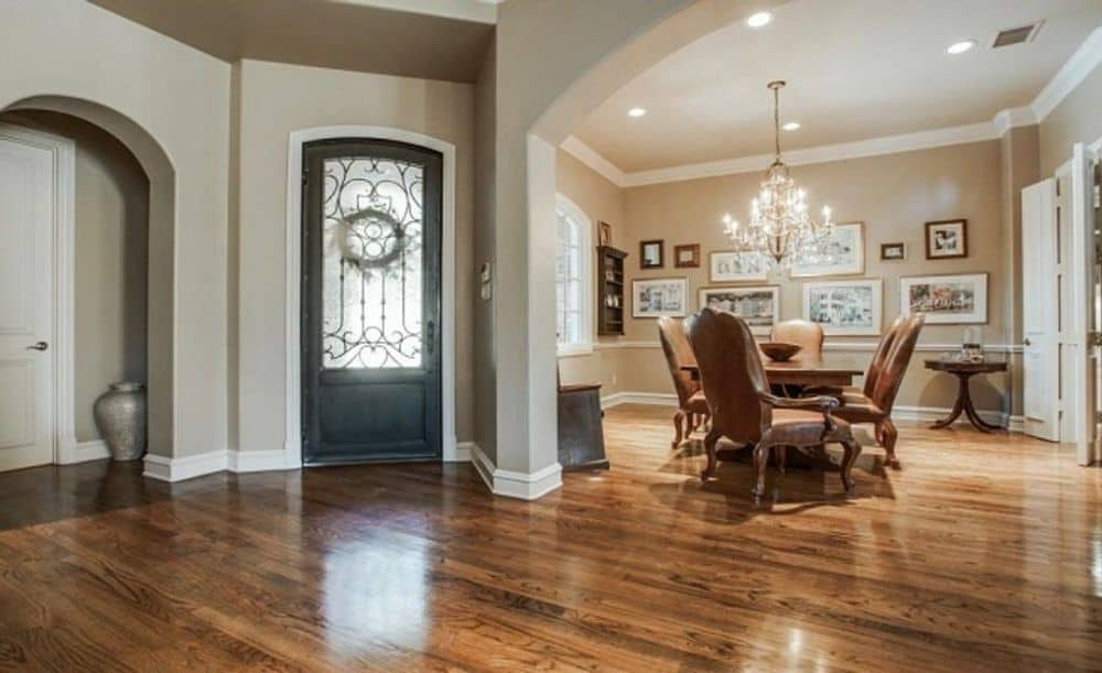 The foyer has a glazed front door and a great view of the formal dining room.