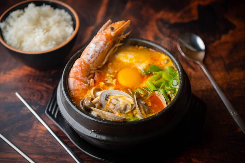 This is a close look at a pot of Korean clam stew with other seafood.