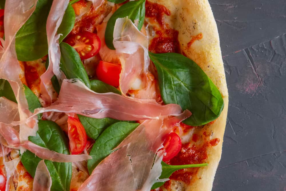 This is a close look at Bacon and Chard Pizza.