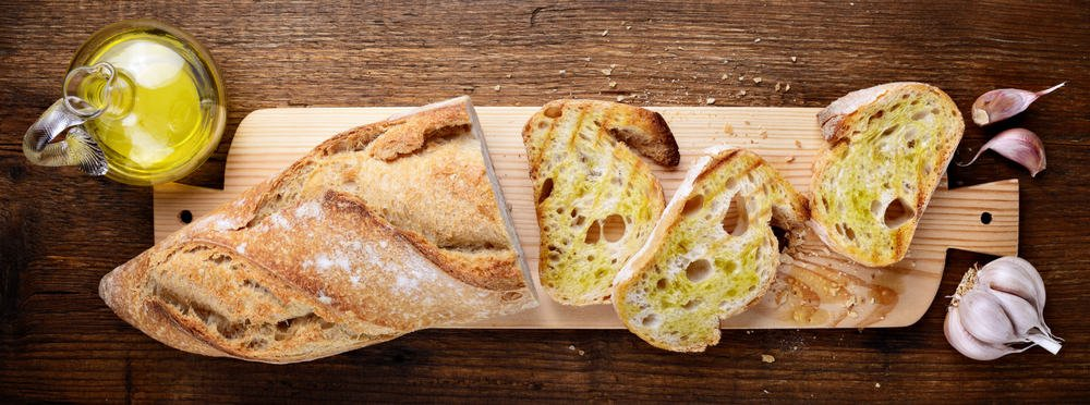 This is a close look at a sliced Garlic and Olive Loaf.