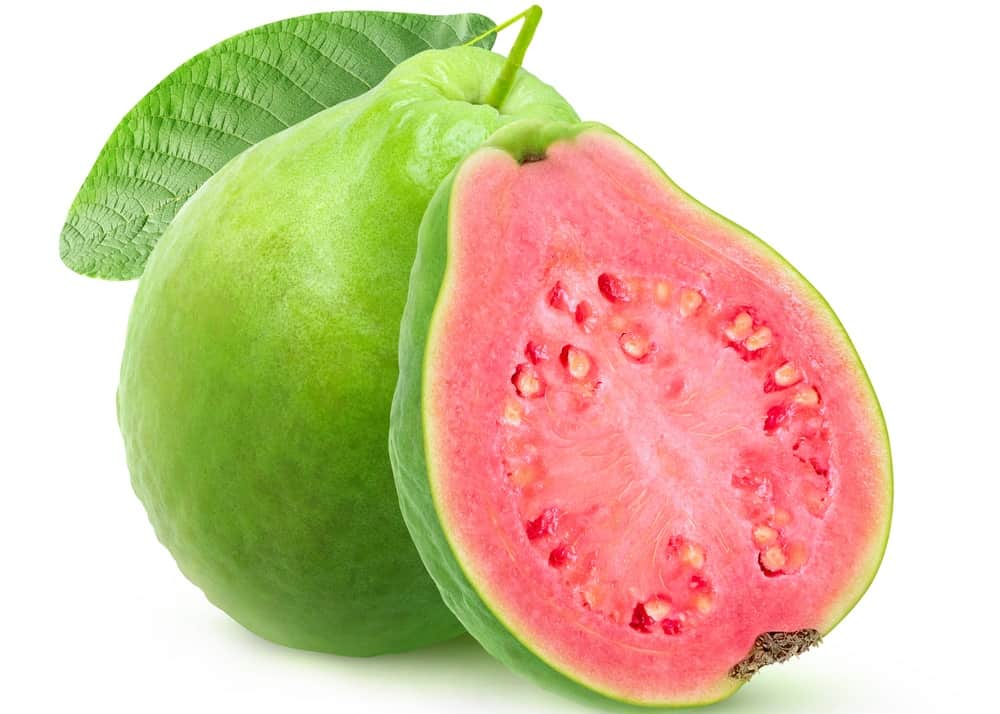 A sliced ripe guava showing a pink meat.