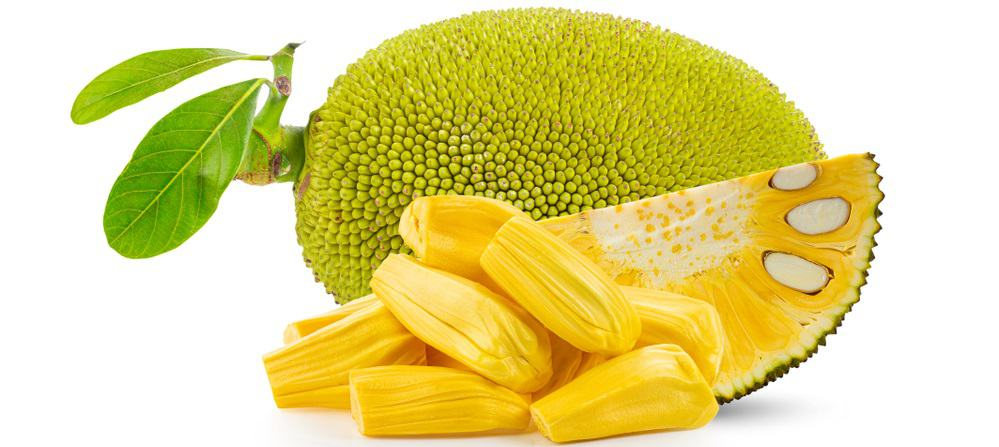A close look at a ripe jackfruit with slices and pieces.