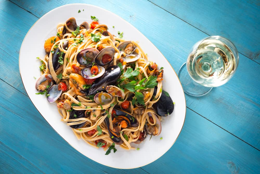 A linguine pasta dish with mussels.