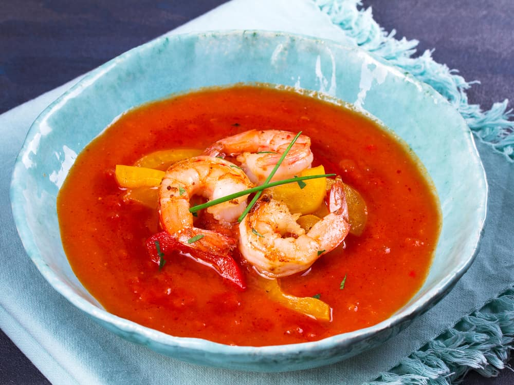 A bowl of spicy cayenne pepper shrimp soup.