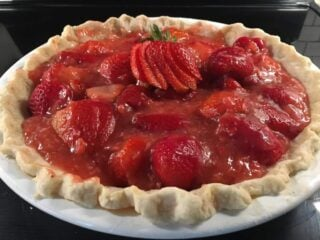 A newly-baked fresh strawberry pie.