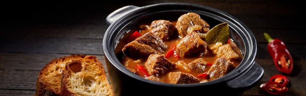 A pot of spicy beef stew with cayenne pepper.