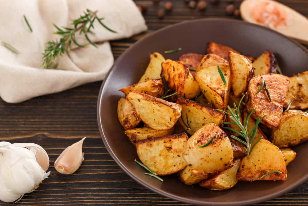 These are roasted potato wedges with herbs and spices.