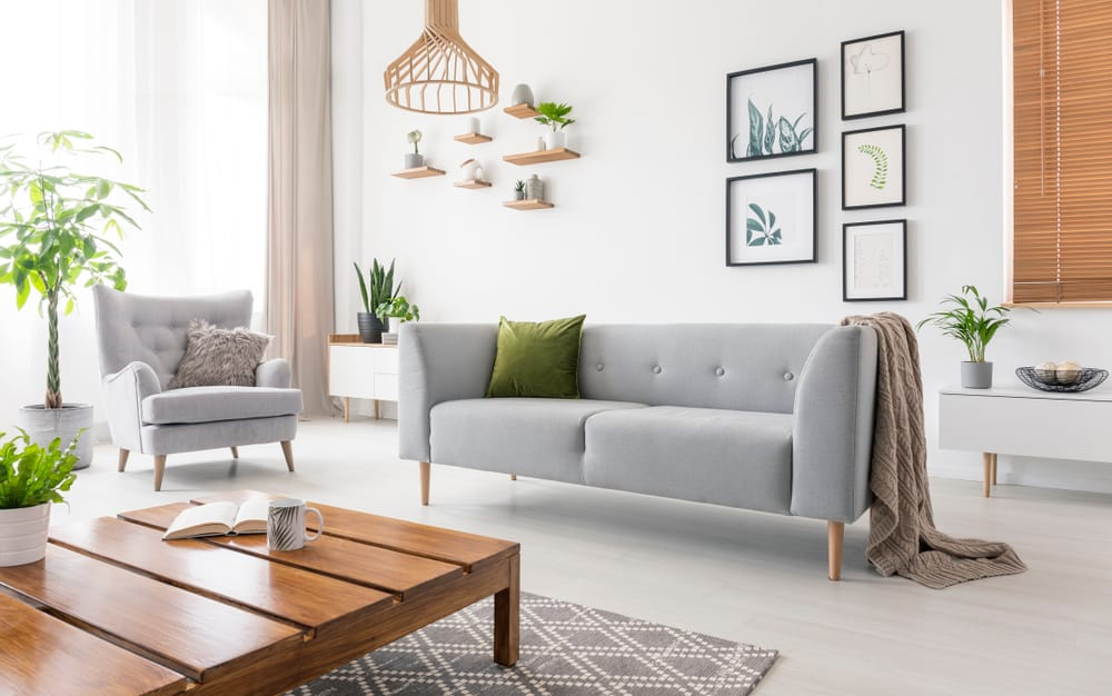This is a look at the bright living room that has a gray bridgewater sofa.