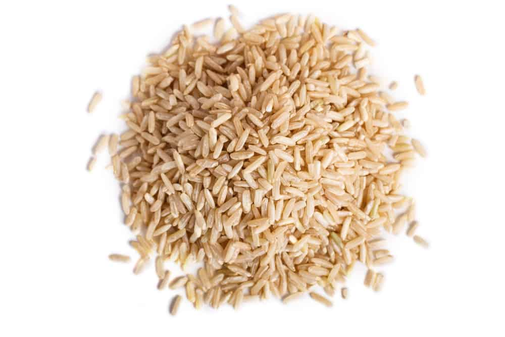 This is a pile of raw brown rice.